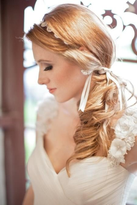 neaon romantic hairstyle with curly side pony stylish ideas for brides