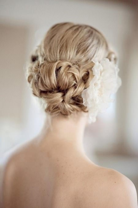 textured bun with curly hair wedding curly hairstyles