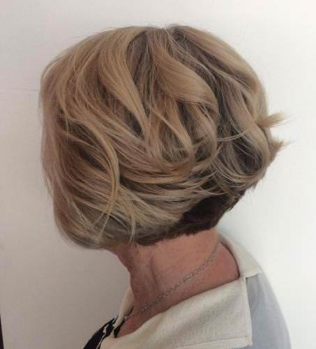 Blonde hairstyle with contrasting layer hairstyles and haircuts for women over 60