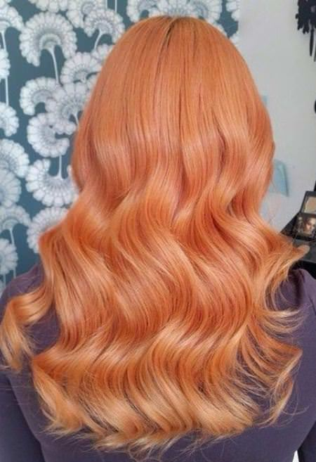 Muted molten color shades of red hair for women