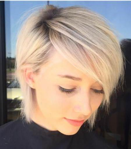 Side parted pixie bob with dark roots short blonde hairstyles and haircuts
