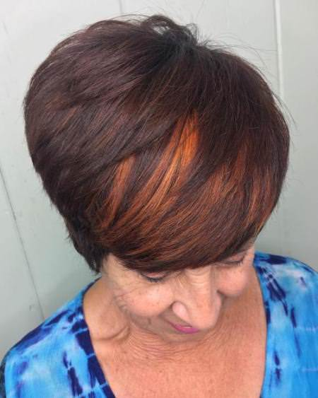 Side swept with brunette hairstyles and haircuts for women over 60