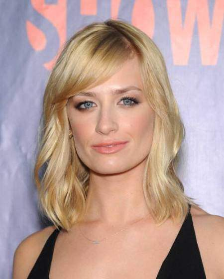 Softly layered haircut with bangs medium blonde hairstyles
