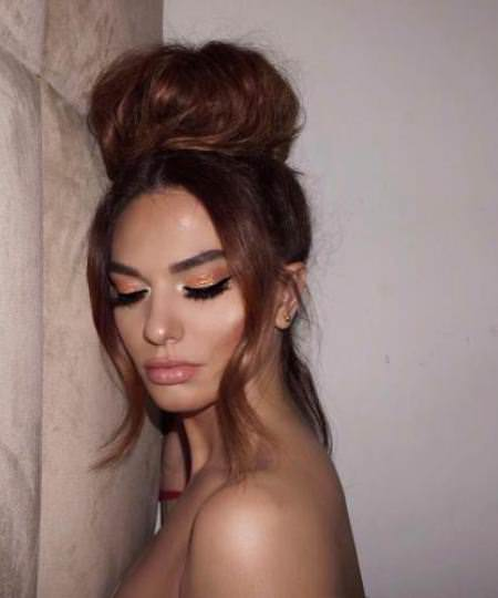 top knot bun iconic braid hairstyles
